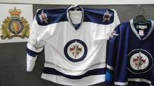 Mounties and Canada Border Services Agency seized a shipment of counterfeit jerseys bearing the newest NHL team's logo and shoulder flashes last week, pictured in this handout photo. (RCMP EDMONTON/THE CANADIAN PRESS)