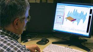 A Samco employee working on a Computer Aided Design station.