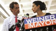 New York mayoral candidate Anthony Weiner and his wife Huma Abedin attend a news conference in New York, July 23, 2013. Weiner said on Tuesday he will stay in the race despite admitting he sent newly revealed sexually explicit online chats and photos even after he resigned from Congress. (ERIC THAYER/REUTERS)