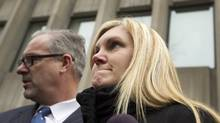 Christine Russell, the widow of Sgt. Ryan Russell, accompanied by Mike McCormack, president of the Toronto Police Association, fights back tears as she speaks about Richard Kachkar, 46, being found not criminally responsible for the death of Sgt. Ryan Russell in Toronto. (Peter Power/The Globe and Mail)