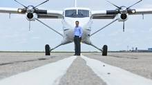 Ken Copiak, plant manager at Viking, stands on the tarmac Friday with the first Alberta-built Twin Otter. (Chris Bolin/CHRIS BOLIN / FOR THE GLOBE AND)