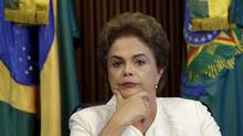 Brazilian President Dilma Rousseff meets with state governors in Brasilia on Friday. While Ms. Rousseff has not been accused of wrongdoing in the Petrobras corruption probe, she is facing impeachment for her government's alleged use of the country's pension fund to shore up budget gaps. (UESLEI MARCELINO/REUTERS)