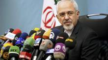 Mohammad Javad Zarif, Iran's foreign minister, fields media questions during a news conference in Tehran on Tuesday, Nov. 26, 2013. (AP)