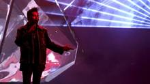 """The Weeknd performs """"Starboy"""" at the American Music Awards at the Microsoft Theater on Sunday, Nov. 20, 2016, in Los Angeles. (Matt Sayles/AP)"""