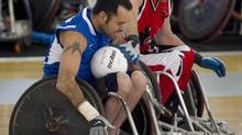 Team Canada's Garett Hickling, right, tries to get the ball from Great Britain player Troye Collins during World Wheelchair Rugby action in Richmond, B.C. Sept. 21, 2010. Hickling will carry the flag for Canada at the Paralympic opening ceremonies in London. (Jonathan Hayward/THE CANADIAN PRESS)