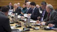 Prime Minister Justin Trudeau, centre, prepares to lead the First Ministers Meeting in Vancouver, B.C., Thursday, March. 3, 2016. (JONATHAN HAYWARD/THE CANADIAN PRESS)