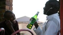A South African local enjoys a Castle Lite, a product made by a subsidiary of SABMiller. (SABMiller PLC/Newscast/SABMiller: Photography)