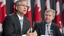 Science Minister Gary Goodyear, left, and task force chairman Tom Jenkins release the final report last year. 'I've heard everything,' an exasperated Mr. Goodyear acknowledged recently. (Adrian Wyld/The Canadian Press/Adrian Wyld/The Canadian Press)