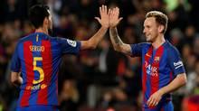 Barcelona's Ivan Rakitic and Sergio Busquets celebrate a goal on March 4, 2017. (Albert Gea/Reuters)