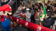 Actor Finn Wolfhard - star of the Netflix hit Stranger Things - joined Mario and eager fans to kick off sales of Nintendo Switch in Toronto at midnight on March 3, 2017. (Hand-out/Nintendo of Canada)