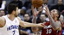 Toronto Raptors forward Andrea Bargnani, left, battles for the ball against Miami Heat forward Michael Beasley, right, during first-half NBA action on Jan. 27, 2010 in Toronto. (Nathan Denette)