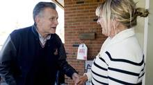 Larry Smith, the Conservative candidate for the riding of Lac-Saint-Louis, speaks with a local resident while campaigning in Kirkland, west of Montreal, on April 7, 2011. (Graham Hughes/THE CANADIAN PRESS)