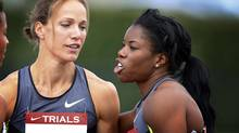 Jessica Zelinka, left, from London, Ont., is congratulated by Perdita Felicien, from Pickering, after Zelinka won the women's 100-metre hurdles at the Canadian Track and Field Championships in Calgary, Alta., Saturday, June 30, 2012. (Jeff McIntosh/THE CANADIAN PRESS)