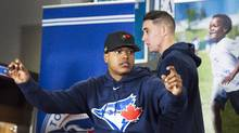 Toronto Blue Jays Aaron Sanchez, right, and Marcus Stroman take part in the Jays Care Foundation after a media availability in Toronto on Tuesday, January 19, 2016. (Nathan Denette/THE CANADIAN PRESS)
