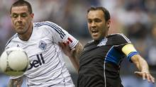 Vancouver Whitecaps Eric Hassli fights for the ball with San Jose Earthquakes Ramiro Corrales (R) during the second half of their MLS soccer game in Vancouver, British Columbia, May 5, 2012. REUTERS/Ben Nelms (Ben Nelms/Reuters)