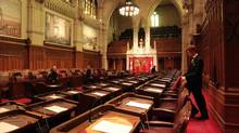 A page prepares the Senate chamber. (Dave Chan For The Globe and Mail)