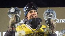 Mark McMorris raises his Crystal Globes at the FIS Snowboard World Cup Big Air event in downtown Quebec City on Feb. 11, 2017. (Jacques Boissinot/THE CANADIAN PRESS)