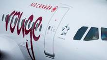 An Air Canada Rouge plane prepares for a flight to Las Vegas at Vancouver International Airport in Richmond, B.C., on Monday, April 28, 2014. (DARRYL DYCK/THE CANADIAN PRESS)