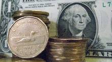 Canadian dollars shown with U.S dollars (Ryan Remior/THE CANADIAN PRES)