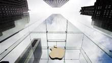 The Apple logo hangs in a glass enclosure above the 5th Avenue Apple Store in New York. (Lucas Jackson/REUTERS)