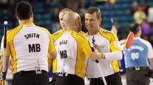 Team Manitoba skip Jeff Stoughton celebrates his team's bronze medal finish after defeating team Quebec with third Jon Mead during the bronze medal draw at the 2014 Tim Hortons Brier curling championships in Kamloops, British Columbia March 9, 2014. (BEN NELMS/REUTERS)