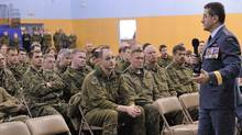 Lieutenant-General André Deschamps, Chief of the Air Staff, addresses the military community in the south side gym at 8 Wing Trenton, on 15 Jan 2010. In the original DND photo, Russell Williams appears on the right; his image has since been cropped out. (Cpl Isabel Lavallee-Raby/PAO/Cpl Isabel Lavallee-Raby/PAO)