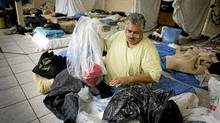 Jim Crawford unpacks his bags at homeless shelter in Vancouver December 16, 2010. The shelter provides space each night for up to 40 people and will operate until the end of April 2011. (JOHN LEHMANN/THE GLOBE AND MAIL)