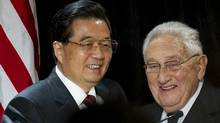 Chinese President Hu Jintao stands alongside former US Secretary of State Henry Kissinger after being introduced prior to speaking during a luncheon for corporate and policy leaders co-hosted by the US-China Business Council and the National Committee on US-China Relations at the Marriott Wardman Park in Washington, DC, January 20, 2011. (SAUL LOEB/Saul Loeb/AFP/Getty Images)
