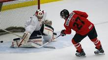 Goalie Jake Peterson makes a save on Ryan Nugent-Hopkins during the red-white team game at the Team Canada selection camp in Calgary, Alberta, December 11, 2012. (TODD KOROL/REUTERS)