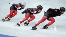 Short track speed skater Charles Hamelin of Canada (R) practises with Canada team members in preparation for the 2014 Sochi Winter Olympics, February 2, 2014. (Reuters)