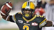 Edmonton Eskimos' Fred Stamps celebrates a touchdown against the Calgary Stampeders during their CFL football game in Edmonton September 7, 2012. (Reuters)