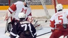 McGill University Redmen goaltender Hubert Morin looks for the puck as it flies past him as teammate Yan Turcotte looks on helplessly as St. Mary's University Huskies Shawn O'Donnell skates in during CIS hockey championship in Thunder Bay, Ont. on Friday March 26, 2010. THE CANADIAN PRESS/Sandi Krasowski (Sandi Krasowski)