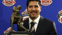 Montreal Alouettes quarterback Anthony Calvillo holds the trophy after being named the CFL's Most Outstanding Player at the CFL Player Awards in Calgary, Alberta November 26, 2009. REUTERS/Todd Korol (TODD KOROL)