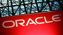 An Oracle sign is shown at the National Retail Federation convention on Tuesday, January 15, 2008 in New York. (MARK LENNIHAN/AP/MARK LENNIHAN/AP)