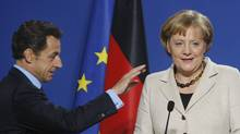 French President Nicolas Sarkozy and German Chancellor Angela Merkel (THIERRY ROGE)