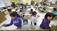 Painting a cardboard minivan are from left Azka Kashif,6; Habiba Abou Amer, 6 and Kayla Agung 6, during their full day kindergarten class at Floradale Public School in Mississauga, Ont. on April 8 2014. (Fred Lum/The Globe and Mail)