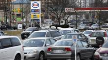 The Esso gas station at Overlea Blvd and Thorncliffe Park Drive in East York is photographed on Dec 30 2014. The price of oil is still low making for lower gasoline prices at the pump for drivers. Most stations are selling regular unleaded for under a dollar per litre. (Fred Lum/The Globe and Mail)