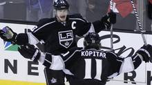 Los Angeles Kings' Dustin Brown (top) celebrates his empty net goal with teammate Anze Kopitar with less than a minute in the third period against the St. Louis Blues on the way to winning Game 4 of their NHL Western Conference semi-final playoff hockey game and the series in Los Angeles, California May 6, 2012. REUTERS/Danny Moloshok (DANNY MOLOSHOK)