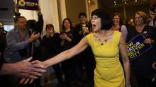 Olivia Chow greets supporters at a rally in Toronto on Sunday, March 16. (Michelle Siu/The Globe and Mail)