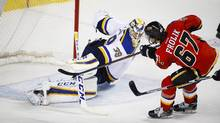 St. Louis Blues goalie Anders Nilsson, left, of Sweden, lets in a goal from Calgary Flames' Michael Frolik, of the Czech Republic, during third period NHL hockey action in Calgary, Monday, March 14, 2016. (Jeff McIntosh/THE CANADIAN PRESS)