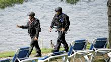 Police patrol the waterfront as seecurity is tight during the Muskoka 2010 G8 Summit in, Huntsville, Ont June 25/2010. (Kevin Van Paassen/The Globe and Mail)