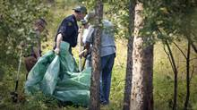 RCMP forensic investigators comb a potential crime scene in Prince George, B.C., on Aug. 28, 2009. (JOHN LEHMANN/John Lehmann/The Globe and Mail)