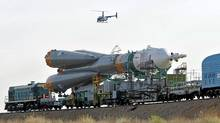 In this Sunday, June 5, 2011, file photo, the Russian Soyuz TMA-02M space ship that will carry new crew to the International Space Station, ISS, is transported from hangar to the launch pad at the Russian leased Baikonur cosmodrome, Kazakhstan. (Dmitry Lovetsky/AP/Dmitry Lovetsky/AP)