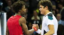 's Gael Monfils (L) shakes hands with Canada's Milos Raonic after their ATP Stockholm Open tennis tournament semi-final match on October 22, 2011 in Stockholm. Monfils won the match 6-7, 6-4, 6-3. Getty Images/JONATHAN NACKSTRAND (JONATHAN NACKSTRAND/Getty Images)