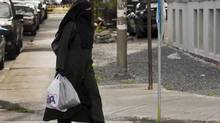 A woman wears a niqab as she walks in Montreal. (RYAN REMIORZ/THE CANADIAN PRESS)
