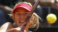 Maria Sharapova of Russia hits a return to Angelique Kerber of Germany during their women's singles semi-finals match at the Rome Masters tennis tournament May 19, 2012. REUTERS (Alessandro Bianchi/Reuters/Alessandro Bianchi/Reuters)