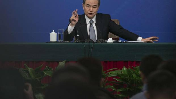 Chinese Foreign Minister Wang Yi announcing 10-year Visa to Canadians