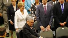 Lieutenant Governor of Ontario David Onley (front) arrives to make his last throne speech, in front of Ontario Premier Kathleen Wynne (2nd L) and former Ontario Premier Dalton McGuinty (2nd R) at the Queen's Park Ontario Legislature in Toronto July 3, 2014. (MARK BLINCH/REUTERS)