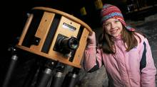 Kathryn Gray, 10, outside her home in Kingsley near Fredericton, New Brunswick, with her dad's reflectiong telescope. (Globe and Mail Photo/Globe and Mail Photo)