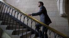 Liberal leader Justin Trudeau makes his way up a set of stairs after speaking with the media following party caucus on Parliament Hill Wednesday April 2, 2014 in Ottawa. (Adrian Wyld/THE CANADIAN PRESS)